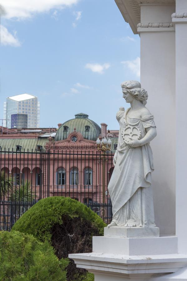 May Pyramid in Plaza de Mayo Buenos Aires, Argentina. Is the oldest national monument in the City of Buenos Aires. Allegory of industry in carrara marble. Pink royalty free stock images