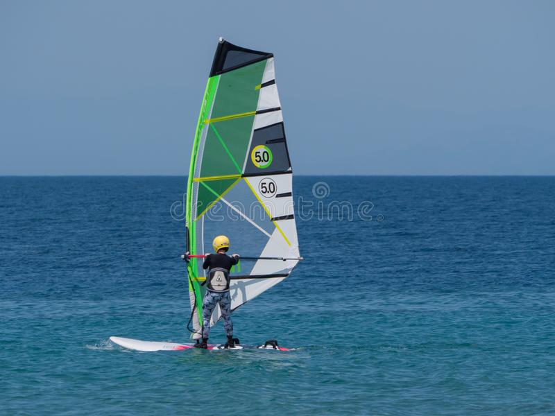 15 may 2019 Rhodes island anonymous person with wind surfing in clear open sea ocean royalty free stock photos