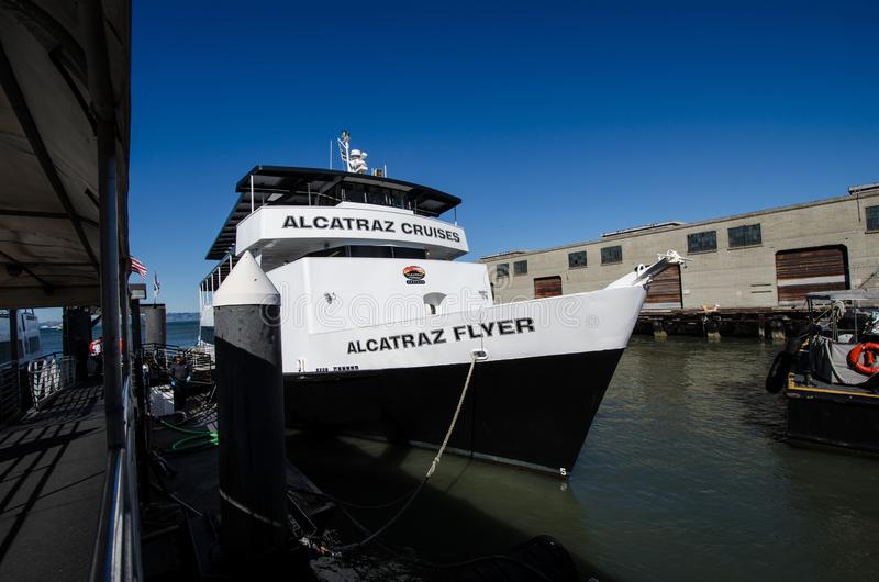 The Alcatraz Cruises boat, the Alcatraz Flyer, transports visitors and tourists to the. SAN FRANCISCO, CALIFORNIA: The Alcatraz Cruises boat, the Alcatraz Flyer royalty free stock photo
