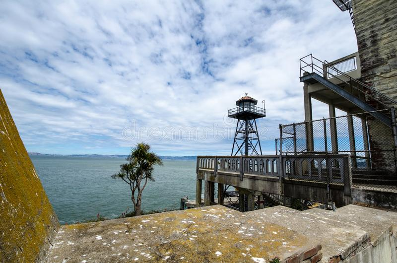 SAN FRANCISCO, CALIFORNIA: Exterior view of Alcatraz Island prison and lighthouse on a sunny day royalty free stock images