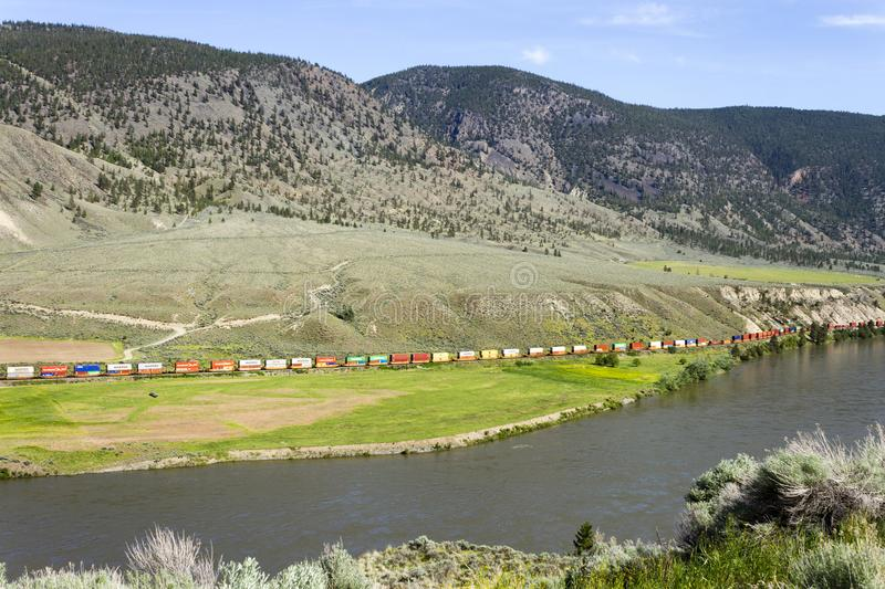 Rail Transportation Industry. May 13, 2018 - Spences Bridge, British Columbia, Canada: A CN Canadian National frieght train transporting freight beside the royalty free stock photos