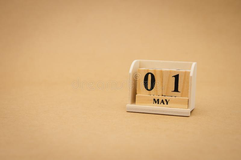 May 1st wooden calendar on vintage wood abstract background. International Labor Day Is a holiday for workers. May 1st wooden calendar on vintage wood abstract royalty free stock photo
