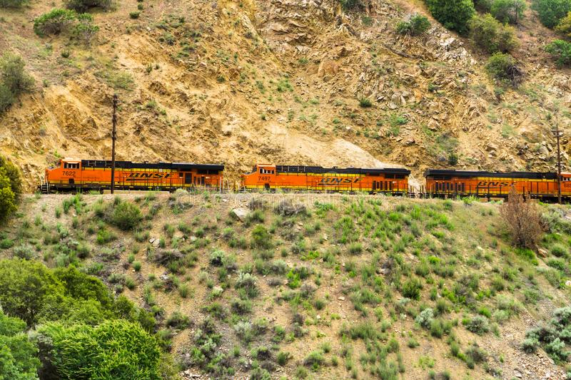 May 25, 2018 Tehachapi / CA / USA - Distinctive orange and yellow Burlington Northern Santa Fe (BNSF) engines travelling through stock photo