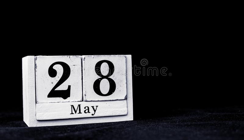 May 28th, Twenty-eighth of May, Day 28 of month May - vintage wooden white calendar blocks on black background with empty space. For text stock photo