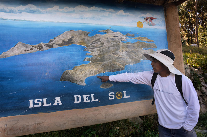 MAY 27, 2015 TITIKAKA LAKE, ISLA DEL SOL, BOLIVIA Local Guide sh. Ows the entrance to the Yumani comminuty in the island stock image
