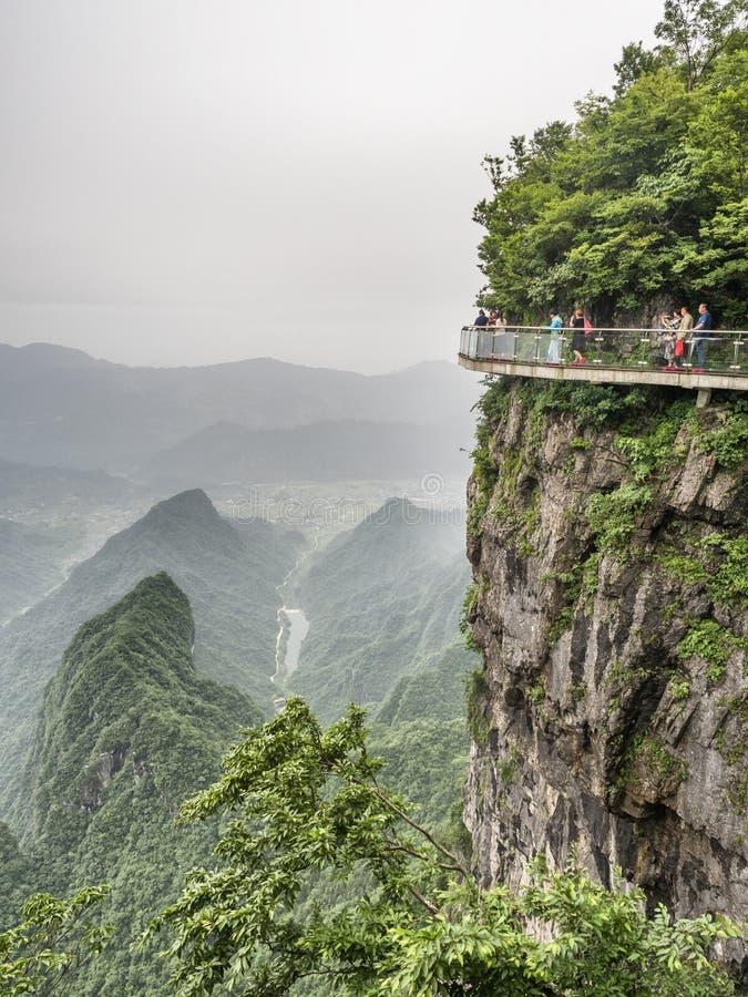 28 May 2018: Tourists walking at The Bridge at Tianmen Mountain, The Heaven`s Gate at Zhangjiagie, Hunan Province, China, Asia royalty free stock image