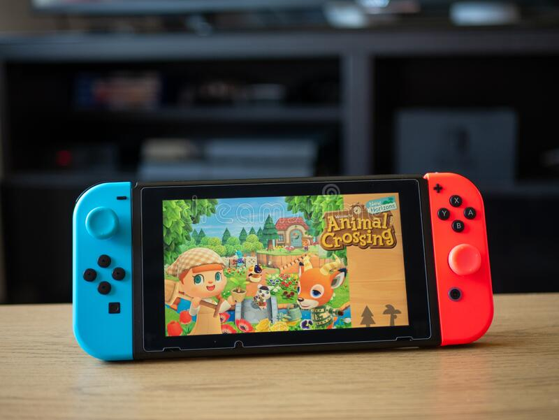 May 2020 Uk Nintendo Switch Console On Table With Animal