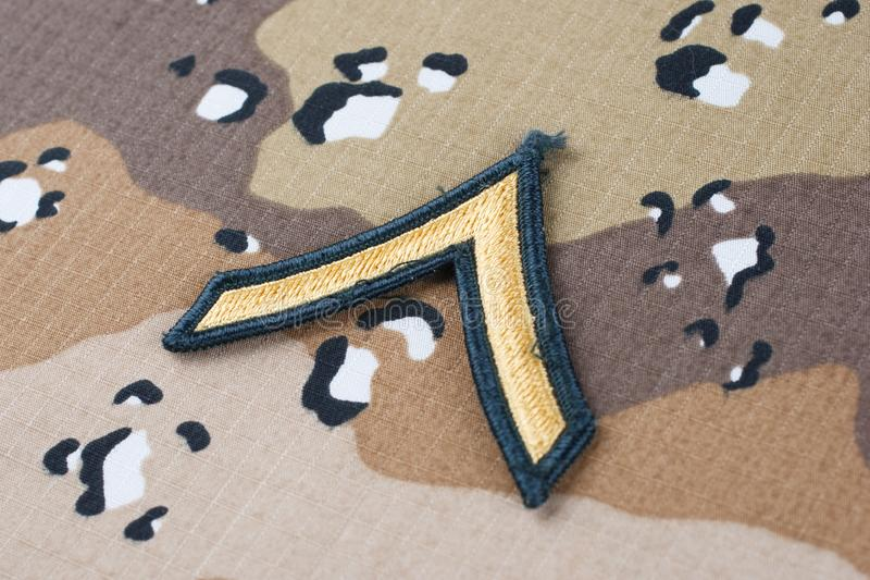 May 12, 2018. US ARMY Private rank patch on Desert Battle Dress Uniform background. May 12, 2018. US ARMY Private rank patch on Desert Battle Dress Uniform stock photography