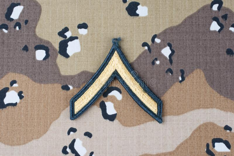 May 12, 2018. US ARMY Private rank patch on desert camouflage uniform background. May 12, 2018. US ARMY Private rank patch on desert camouflage uniform royalty free stock image