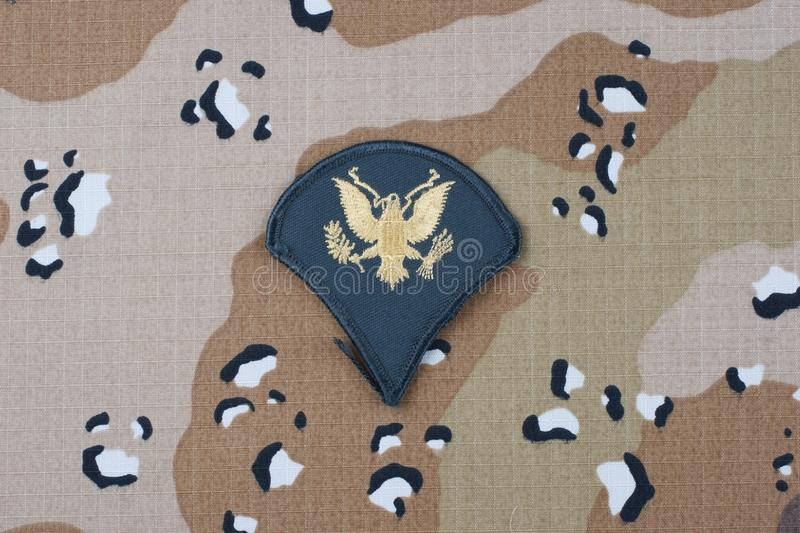 May 12, 2018. US ARMY Specialist rank patch on desert camouflage uniform background. May 12, 2018. US ARMY Specialist rank patch on desert camouflage uniform stock photo