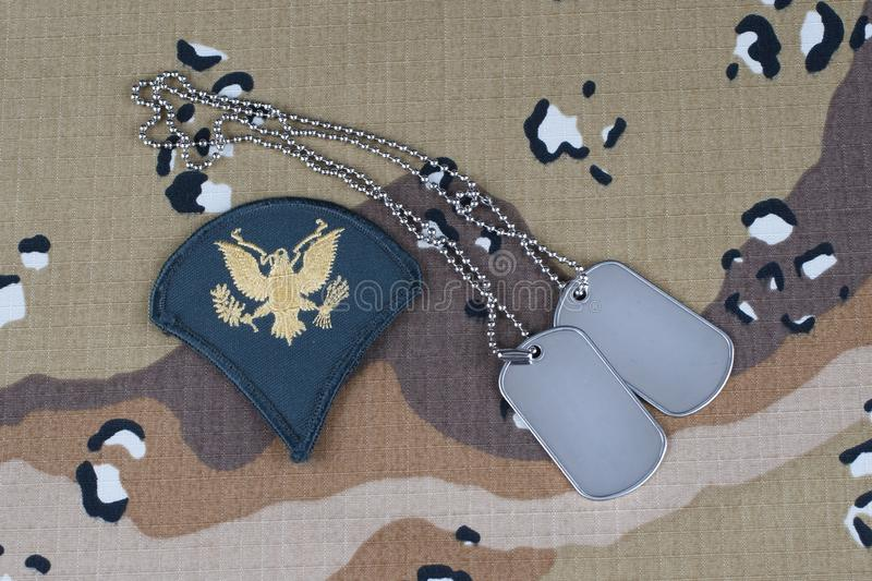 May 12, 2018. US ARMY Specialist rank patch and dog tags on desert camouflage uniform background. May 12, 2018. US ARMY Specialist rank patch and dog tags on stock images