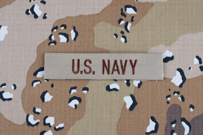 May 12, 2018. US NAVY branch tape on desert camouflage uniform background stock image