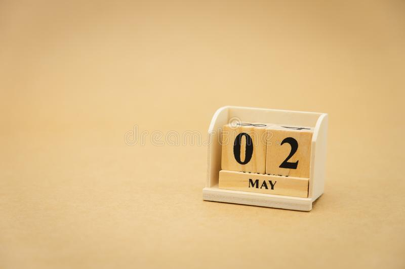 May 2 wooden calendar on vintage wood abstract background. using as background Universal day concept with copy space for your text. Or design stock images