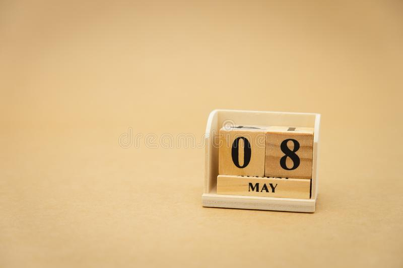 May 8 wooden calendar on vintage wood abstract background. using as background Universal day concept with copy space for your text. Or design royalty free stock images