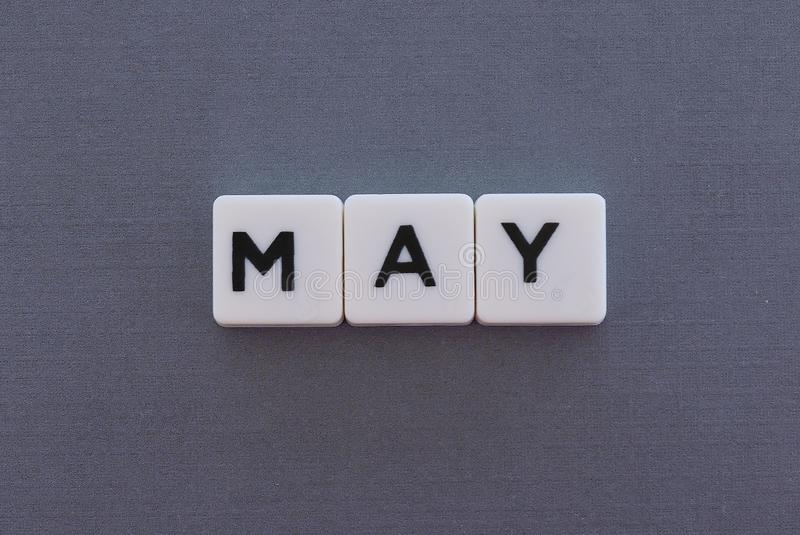 May word made of square letter word on grey background. Month time day date monthly calendar concept text spring reminder design number hello diary holiday year stock images