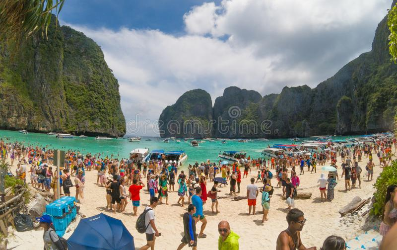 Too many tourists on Maya Beach. Maya Beach, Thailand, August 19th 2017: Over crowded and polluted Maya Beach stock photography