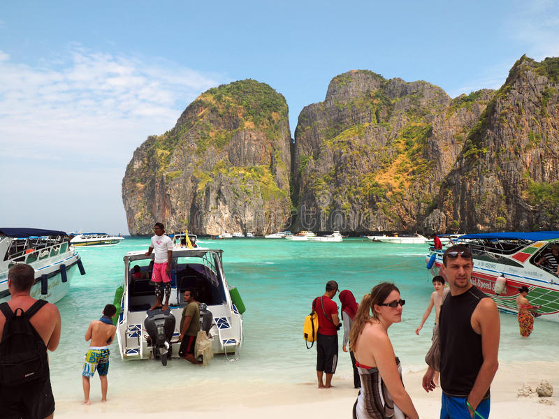 Maya beach Thailand. MAYA BAY, THAILAND - FEBRUARY, 2015: Crowds of visitors enjoy a day trip at Maya Bay, one of the iconic beaches of Phi Phi islands of royalty free stock photo