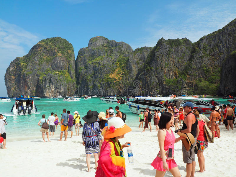 Maya beach Thailand. MAYA BAY, THAILAND - FEBRUARY, 2015: Crowds of visitors enjoy a day trip at Maya Bay, one of the iconic beaches of Phi Phi islands of royalty free stock photos