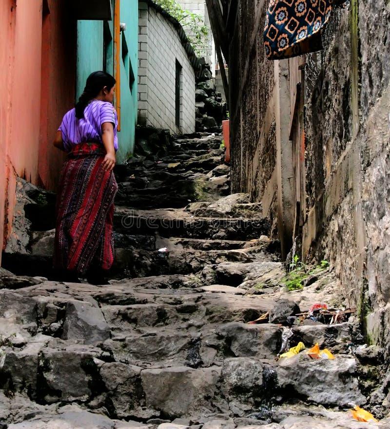 Guatemalan Maya. A Guatemalan Maya woman climbing stairs in a city
