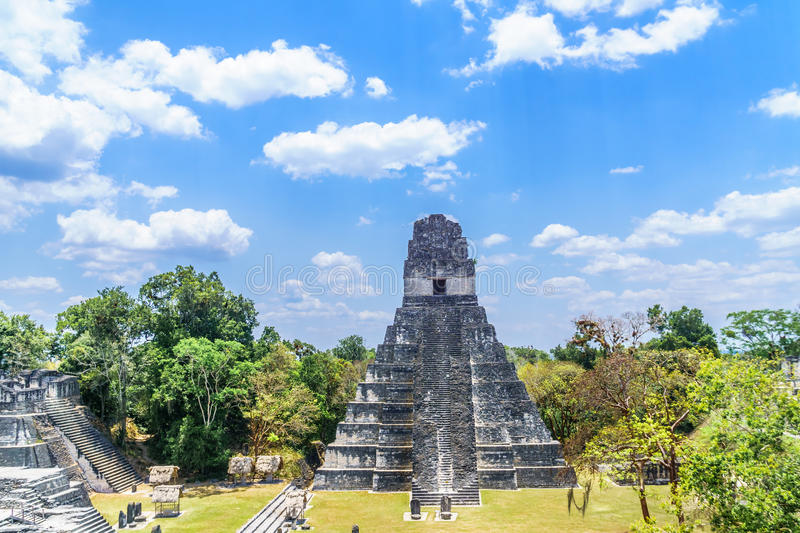 Maya pyramids in national park Tikal in Guatemala. View over Maya pyramids and temples in national park Tikal in Guatemala royalty free stock photography