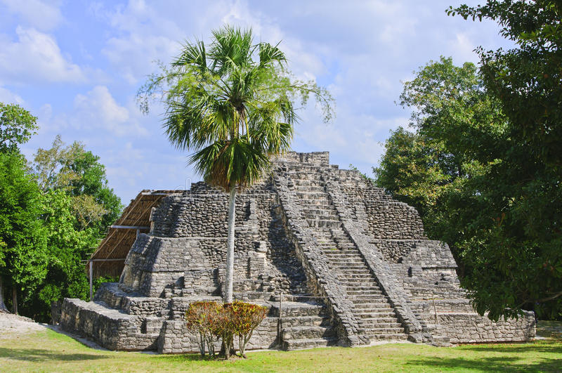 Chacchoben Mayan Temple, Costa Maya, Mexico. The remains of the stone Temple II located on the Great Base ceremonial center in the Mayan ruins known as royalty free stock images