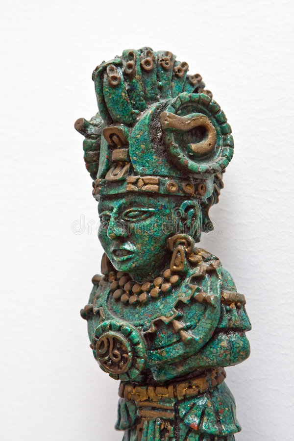 Maya warrior figure. A statue figure of a decorated Maya warrior made of Jade stones isolated on white royalty free stock images