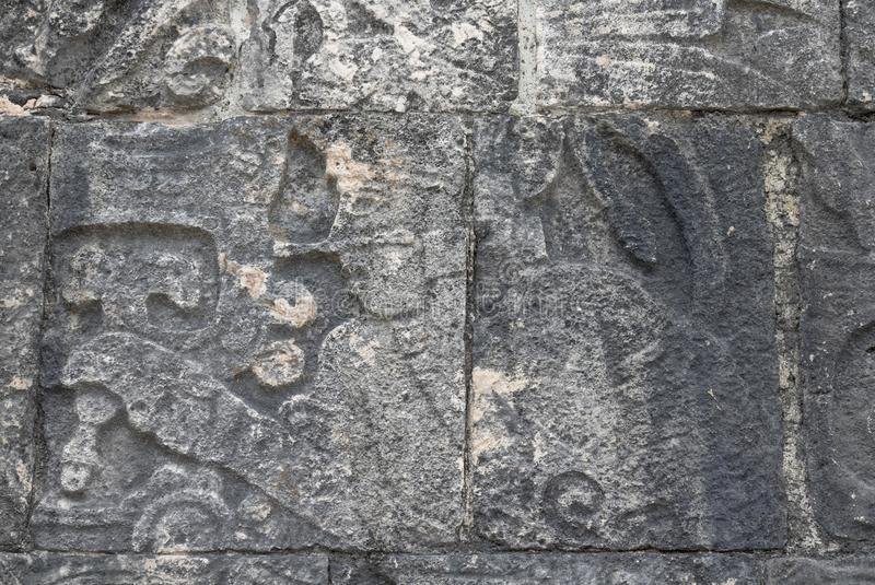 Mayan ball player. Sculpted on bas relief on the court wall. Detail on Chichen Itza stadium carved on stone. Players had feathered helmets and leather padding royalty free stock image