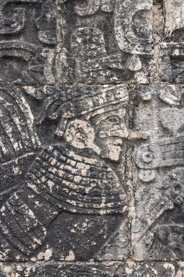 Mayan ball player. Sculpted on bas relief on the court wall. Detail on Chichen Itza stadium carved on stone. Players had feathered helmets and leather padding stock images