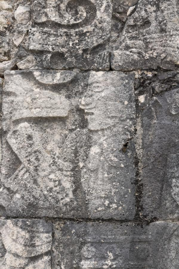Mayan ball player. Sculpted on bas relief on the court wall. Detail on Chichen Itza stadium carved on stone. Players had feathered helmets and leather padding royalty free stock photos
