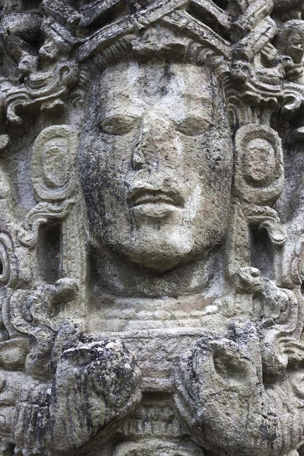 Mayan Face Stone Carving Copan Ruinas Archeological Site Honduras. Mayan Face Carved in Stone Temple Building in World Famous Copan Ruins Archeological Site of stock image