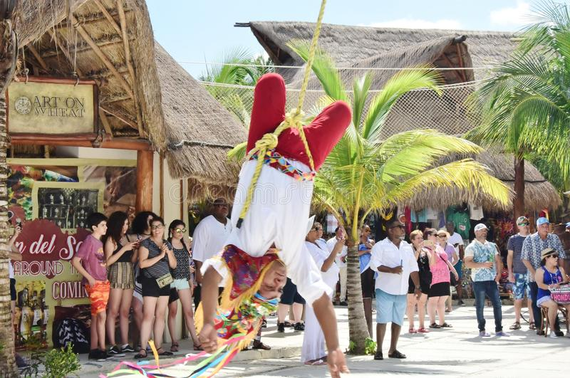 Touchdown By Flying Mayan Indian Town Center Costa Maya Mexico. Mayan Indian man finally mad it down from a dangerous yet powerful performance in town square in stock photography