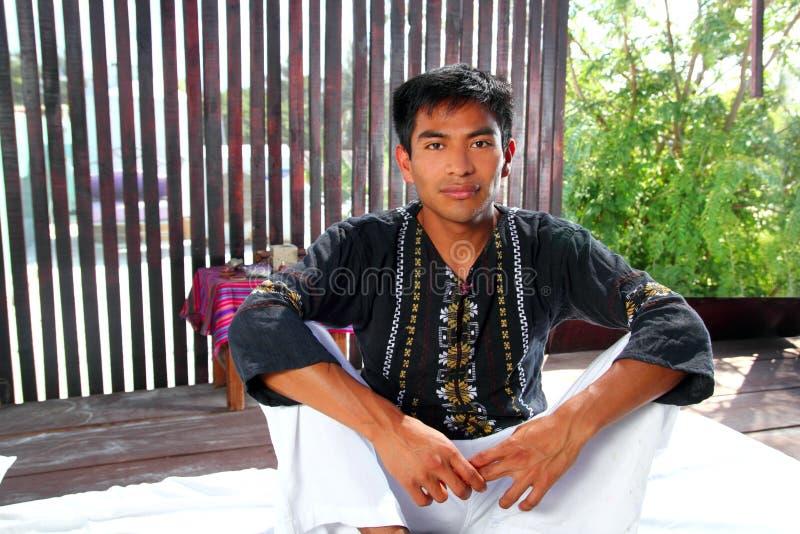 Mayan indian native man in jungle hut