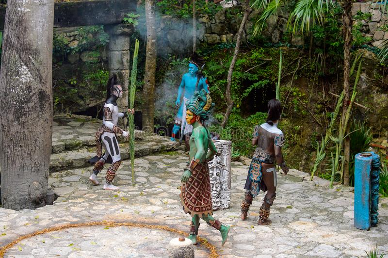 Mayan people in Mexico. XCARET, MEXICO - NOV 8, 2015: Unidentified men with body paint dressed as the Maya indian. The Mayan are a group of Indigenous people of royalty free stock photo
