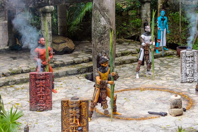 Mayan people in Mexico. XCARET, MEXICO - NOV 8, 2015: Unidentified men with body paint dressed as the Maya indian. The Mayan are a group of Indigenous people of stock images