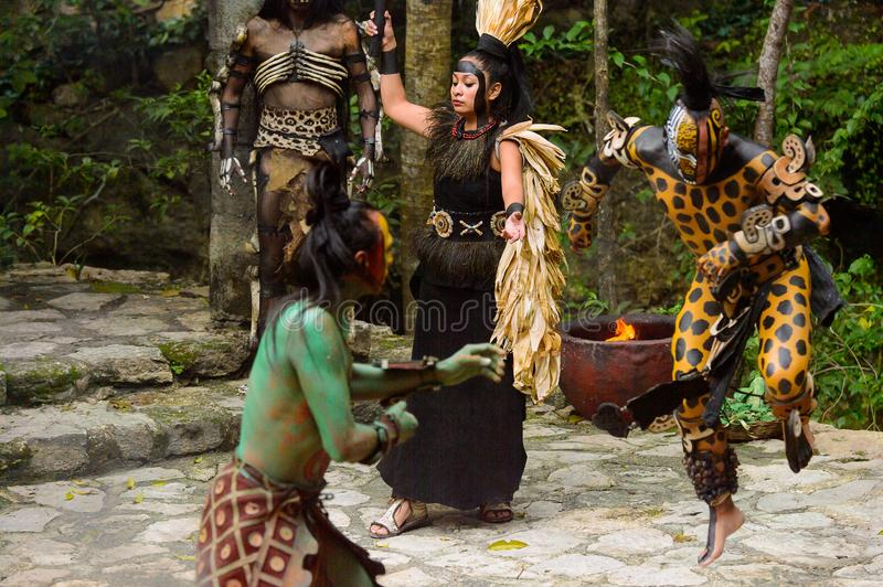 Mayan people in Mexico. XCARET, MEXICO - NOV 8, 2015: Unidentified man prays with the green body paint dressed as the Maya indian . The Mayan are a group of stock photo