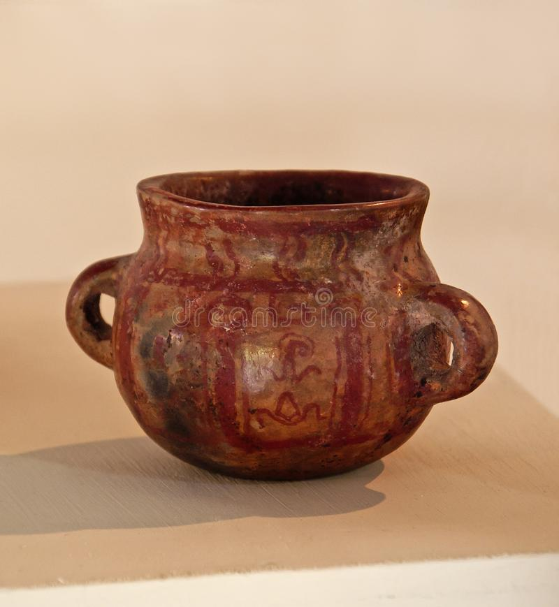 Mayan pottery, Copán. Mayan two-handled clay pottery pot found at Copán Ruinas, Honduras This is a funerary offering, and was found in a burial stock photography
