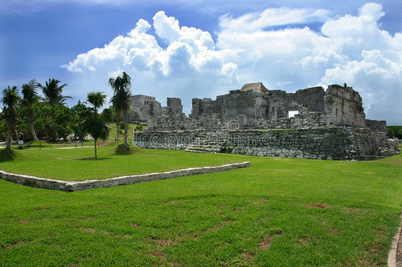 Mayan Ruins. In Tulum Mexico. Dramatic clouds paint a scene of an past time stock image