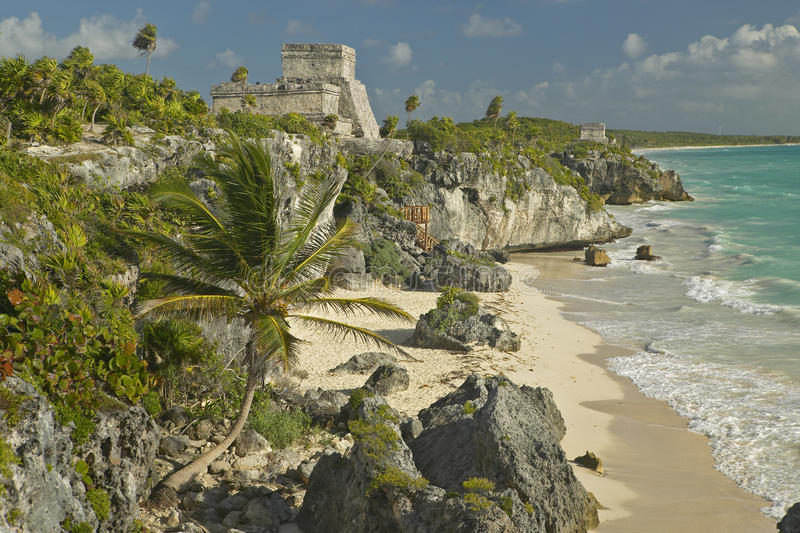 Mayan ruins of Ruinas de Tulum (Tulum Ruins) in Quintana Roo, Mexico. El Castillo is pictured in Mayan ruin in the Yucatan. Peninsula, Mexico at sunset, with stock photo