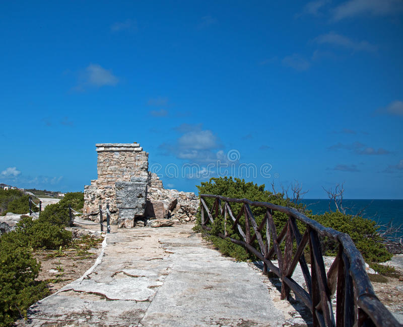 Mayan Shrine / Altar / Temple on Isla Mujeres Mexico. Wooden railing along path leading to Mayan Temple / Altar / Shrine at Punta Sur southern point which also royalty free stock images