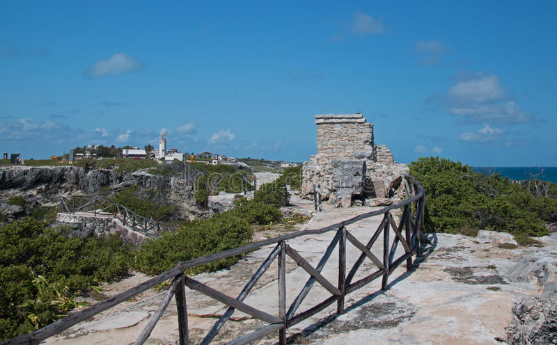 Mayan Shrine / Altar / Temple on Isla Mujeres Mexico. Wooden railing along path leading to Mayan Temple / Altar / Shrine at Punta Sur southern point which also royalty free stock image