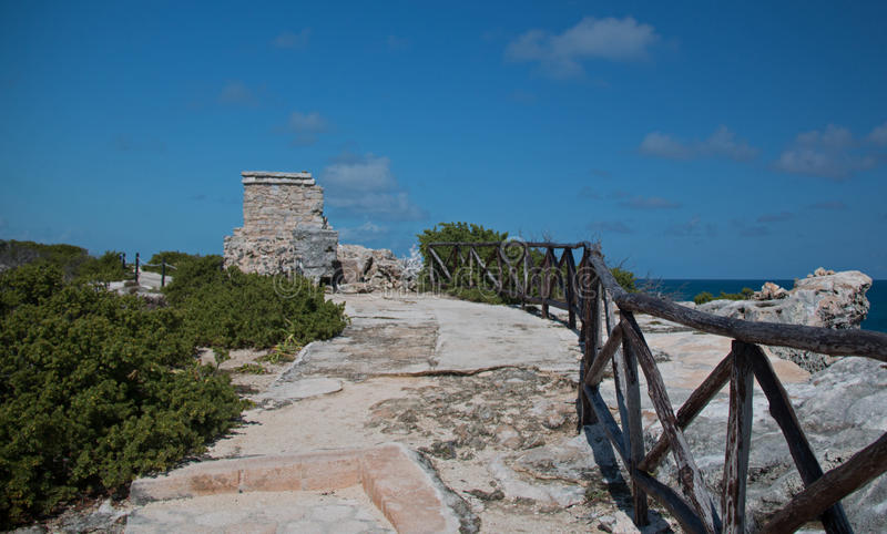 Mayan Shrine / Altar / Temple on Isla Mujeres Mexico. Wooden railing along path leading to Mayan Temple / Altar / Shrine at Punta Sur southern point which also stock photos