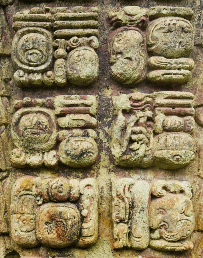 Mayan stone carved writing icons stock image