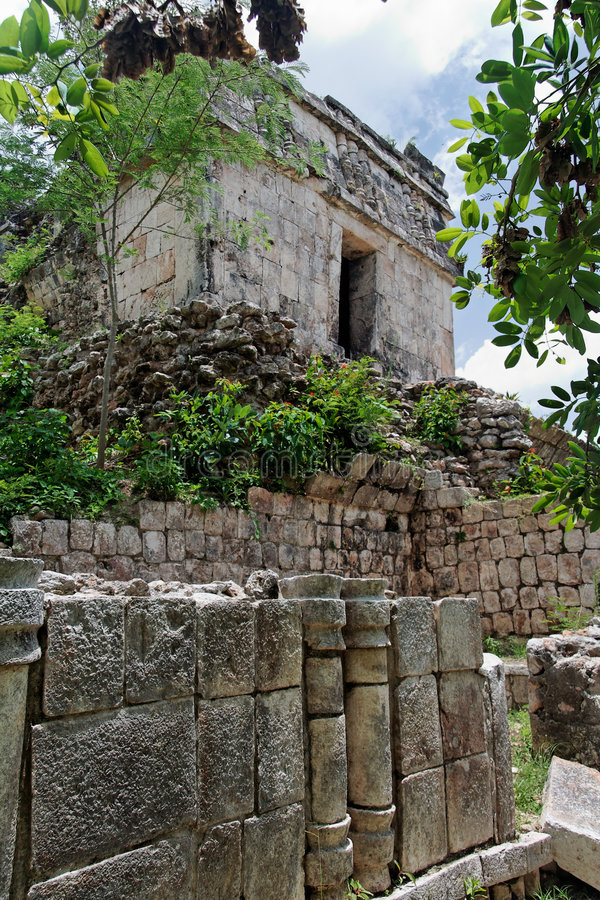 Mayan Temple in Kabah Yucatan Mexico. The facade of the ruins of a Mayan temple between the trees of the tropical jungle.. The archaeological site of Kabah royalty free stock photo