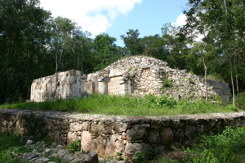 Mayan tomb in jungle. Maya ruins in green jungle over blue sky royalty free stock images