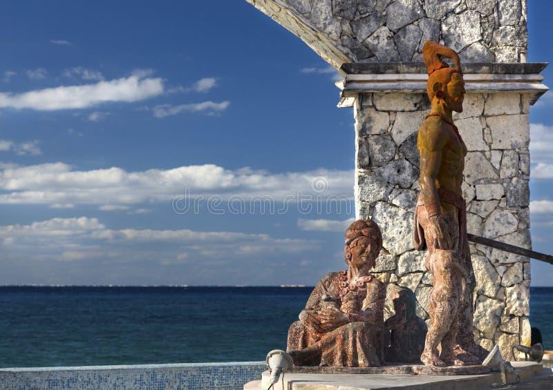 Cross Breeding Monument Aztec Warrior Mayan Woman Cozumel Mexico Waterfront. Mayan Woman Aztec Warrior Bronze Sculpture Cross Breeding Monument Public Art on stock photography
