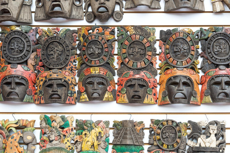Mayan wooden handcrafted masks stock photos