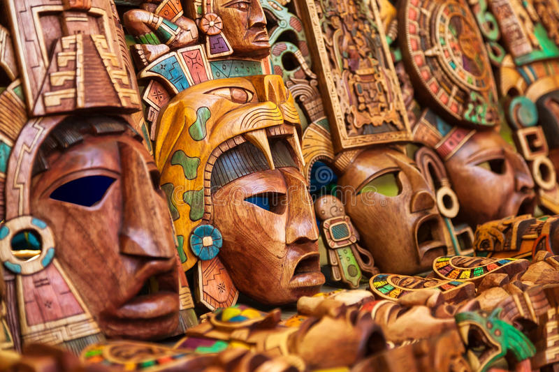 Mayan wooden handcrafted masks stock photography