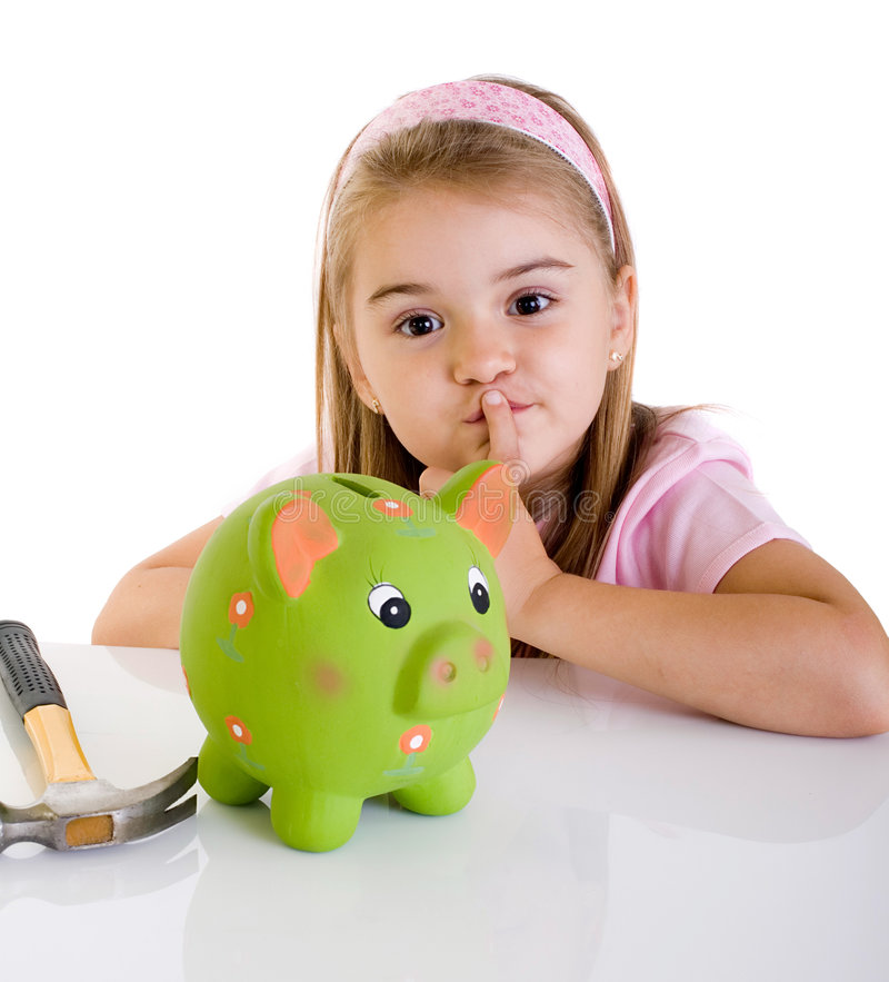 Maybe... Little girl thinking how to open piggy bank stock photography