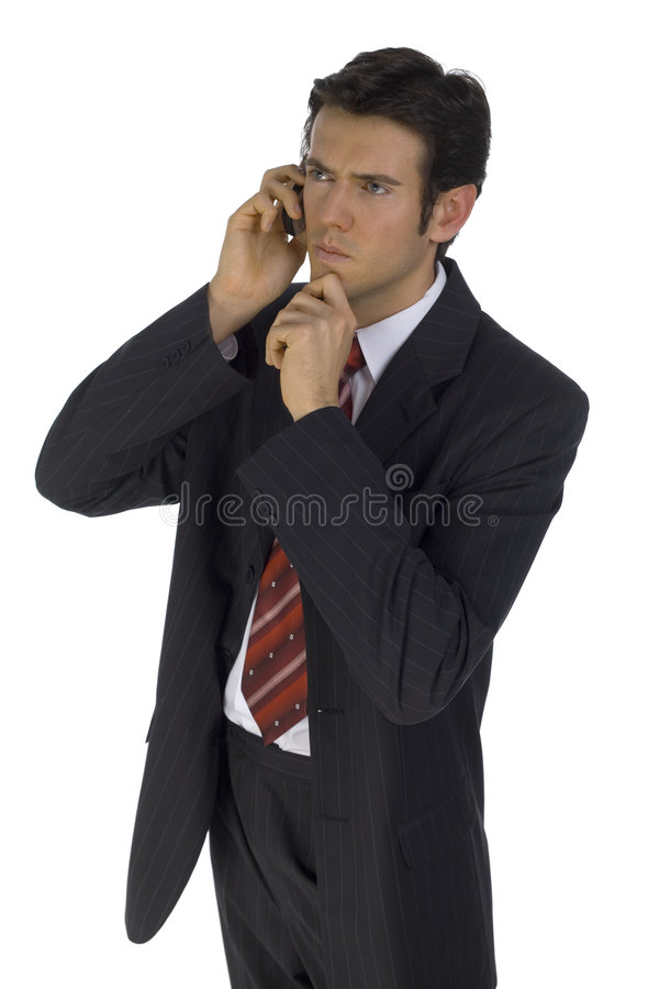 Maybe you're right... Young, handsome businessman. Talking by mobile phone. Wondering about something. Isolated on white in studio royalty free stock photo