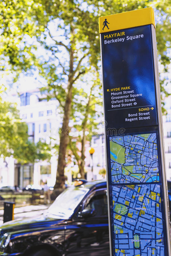 Mayfair road sign with map in London city centre. LONDON, UNITED KINGDOM - August 12th, 2016: Mayfair road sign with map and street bokeh in London city centre stock photo
